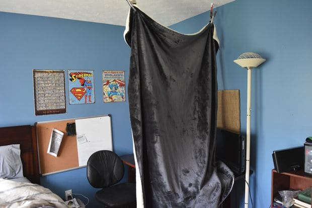 To make this simple DIY vocal booth, simply hang a thick blanket in your studio. This will block sound and help you record better vocals.