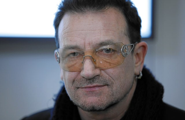 Bono, an artist that has made some insanely wise investments, is seen here wearing his famous orange sunglasses.