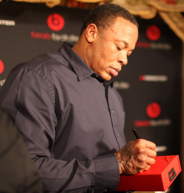 Dr Dre, the only billionaire of Hip-Hop, is seen here autographing a pair of Beats Headphones.