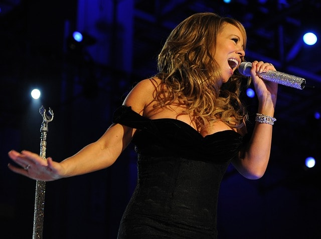 Mariah Carey, a very rich musician, performing at a show.
