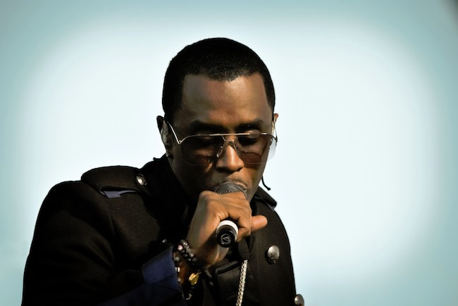 Sean 'Diddy' Combs is seen here posing for a photoshoot, holding a microphone.
